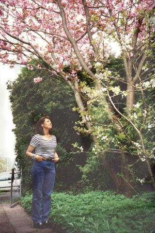 Claudia watching a blossoming tree